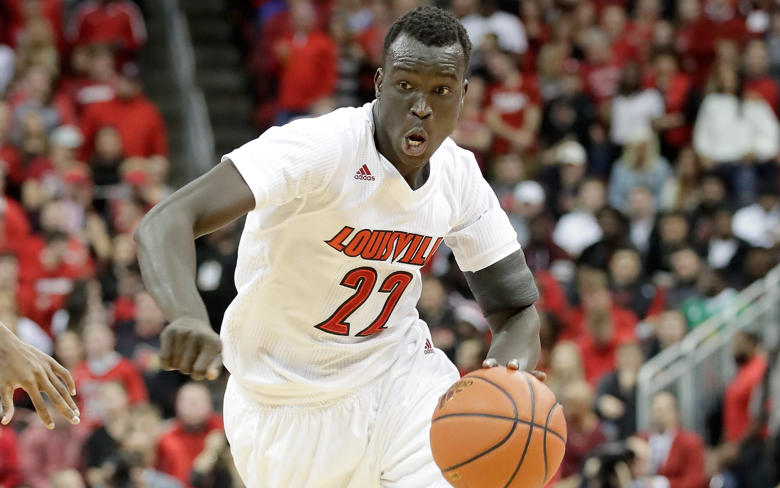 LOUISVILLE, KY - DECEMBER 21: Deng Adel #22 of the Louisville Cardinals dribbles the ball during the game against the Kentucky Wildcats at KFC YUM! Center on December 21, 2016 in Louisville, Kentucky. (Photo by Andy Lyons/Getty Images)