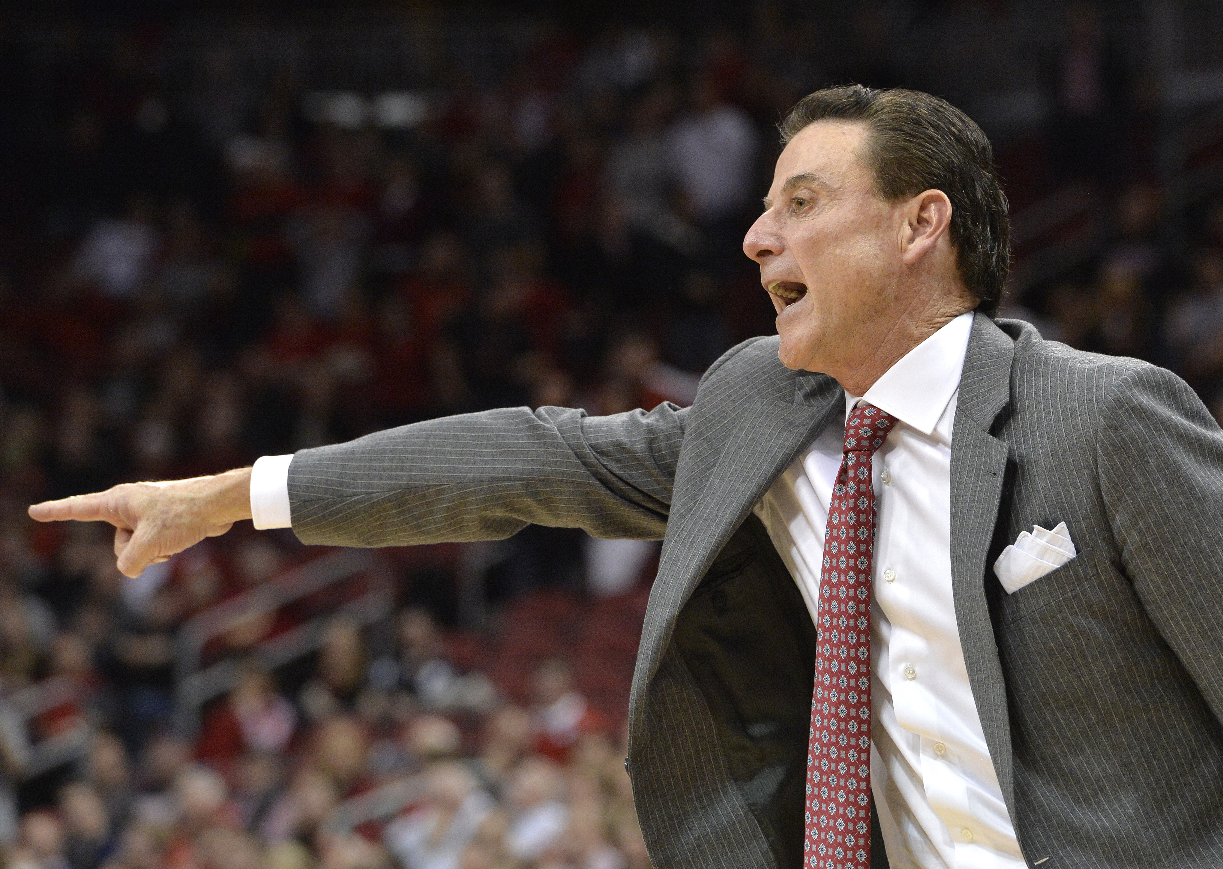 Louisville's head coach Rick Pitino shouts instructions to his team during the second half of an NCAA college basketball game against Virginia, Wednesday, Dec. 28, 2016, in Louisville, Ky. Virginia won 61-53. (AP Photo/Timothy D. Easley)