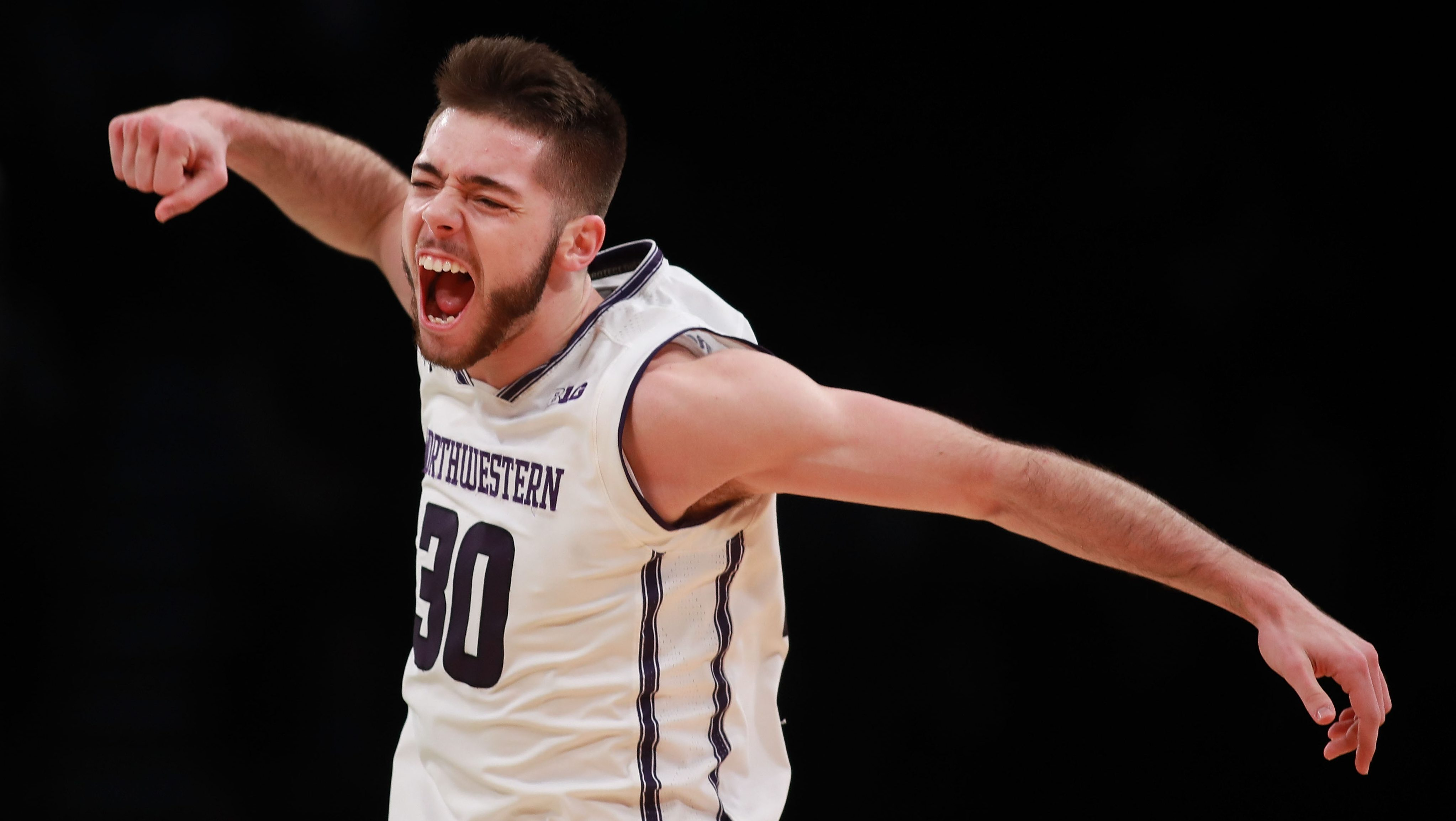 NEW YORK, NY - NOVEMBER 22: Bryant McIntosh #30 of the Northwestern Wildcats celebrates after hitting a three pointer against the Notre Dame Fighting Irish in the second half during the championship game of the Legends Classic at Barclays Center on November 22, 2016 in the Brooklyn borough of New York City. (Photo by Michael Reaves/Getty Images)