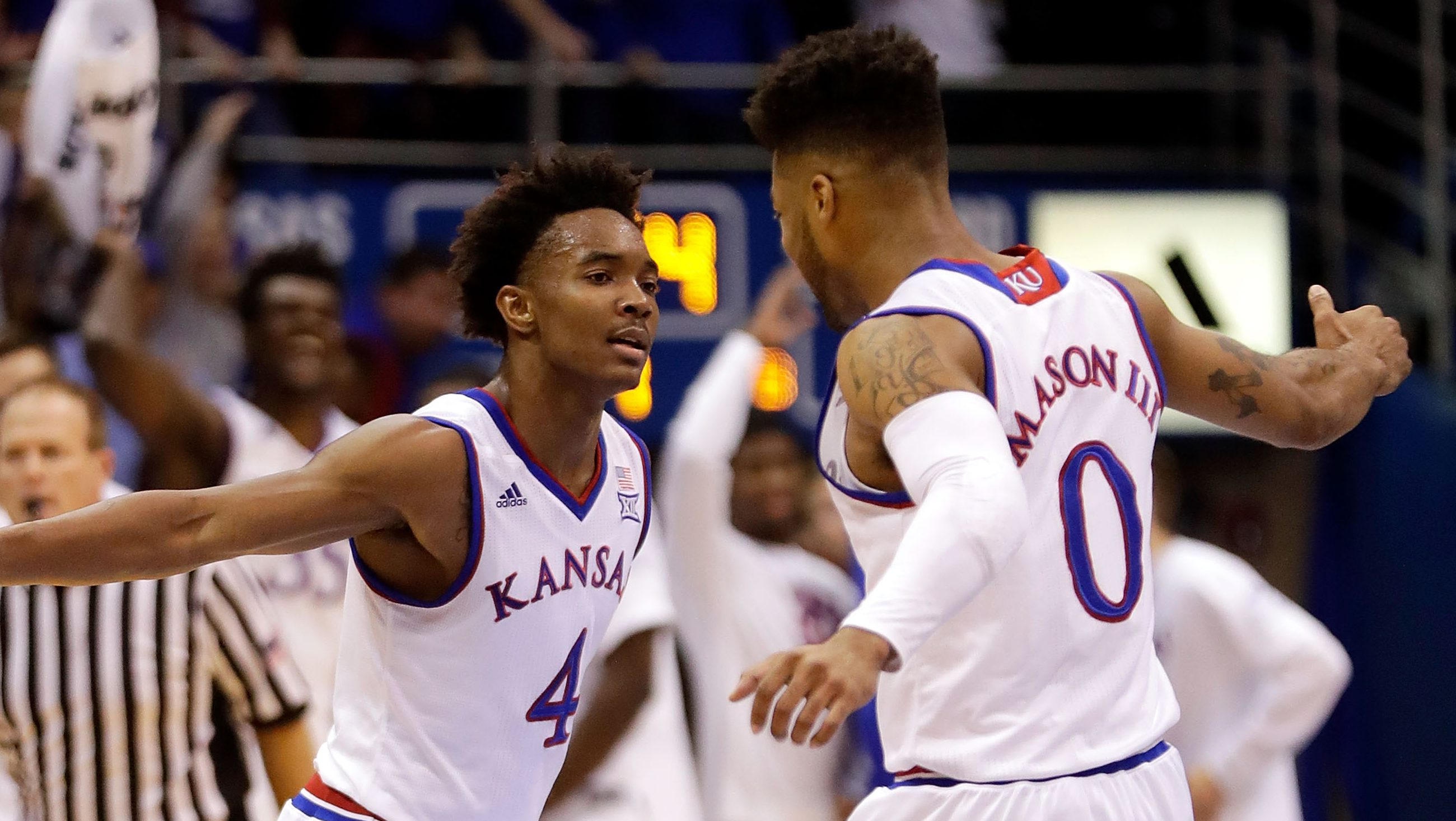 LAWRENCE, KS - DECEMBER 03:  Devonte' Graham #4 of the Kansas Jayhawks celebrates with Frank Mason III #0 after making a three-pointer during the game against the Stanford Cardinal at Allen Fieldhouse on December 3, 2016 in Lawrence, Kansas.  (Photo by Jamie Squire/Getty Images)