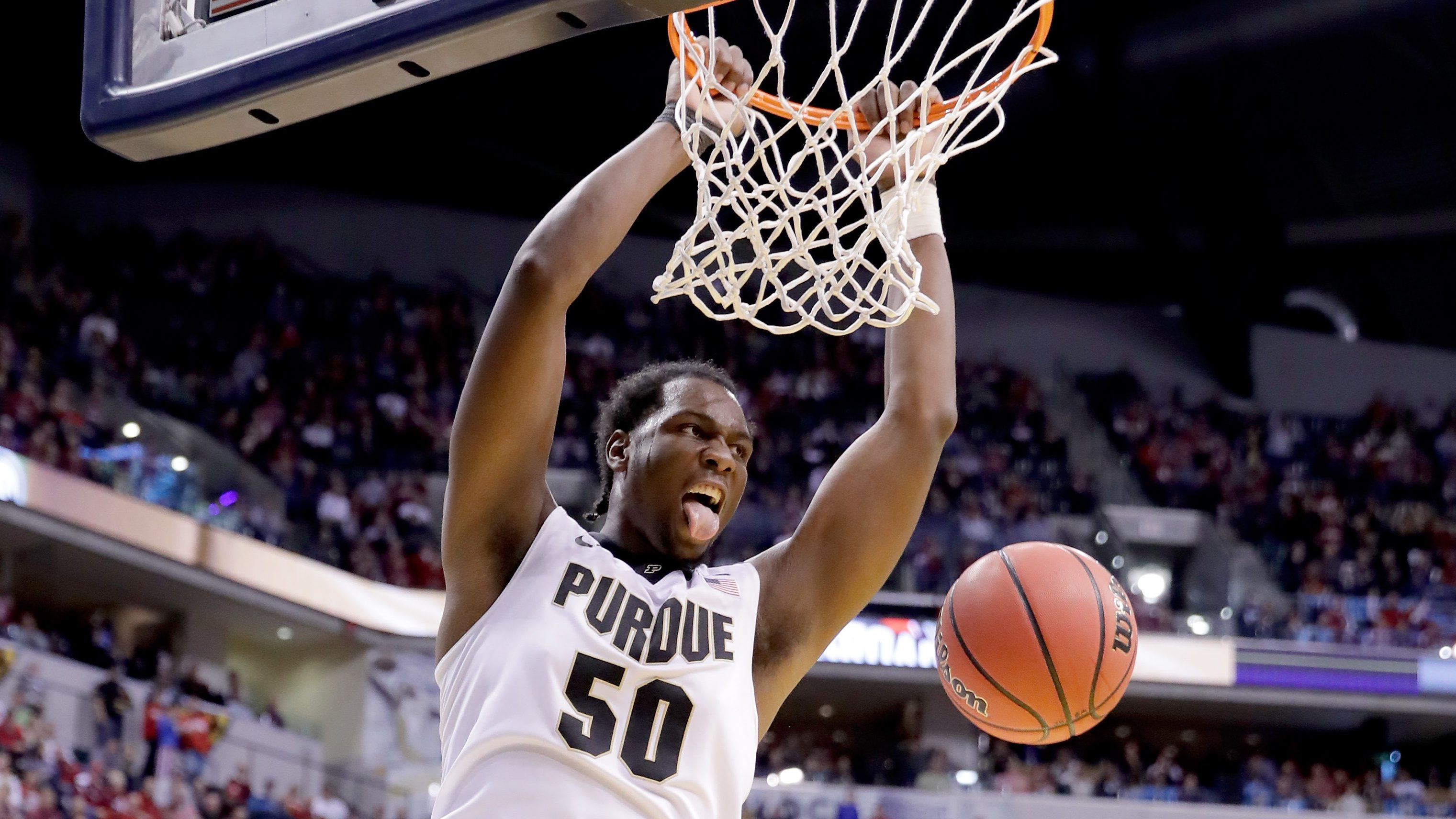 INDIANAPOLIS, IN - DECEMBER 17:  Caleb Swanigan #50 of the Purdue Boilermakers dunks the ball during the game against the Notre Dame Fighting Irish during the Crossroads Classic at Bankers Life Fieldhouse on December 17, 2016 in Indianapolis, Indiana.  (Photo by Andy Lyons/Getty Images)