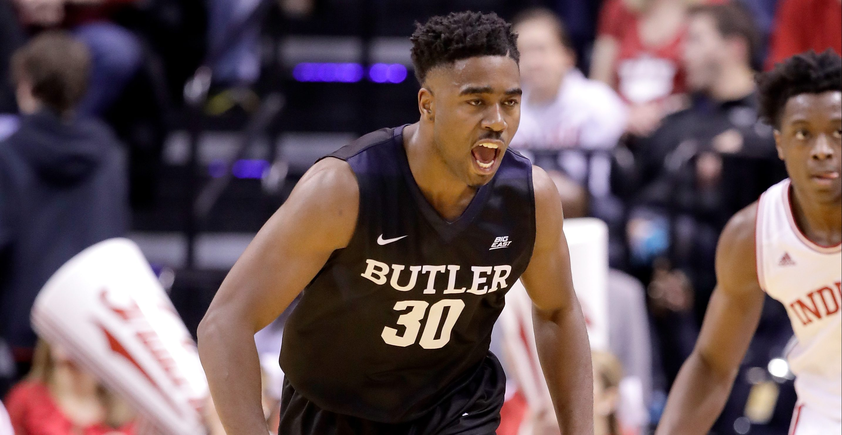 INDIANAPOLIS, IN - DECEMBER 17:   Kelan Martin #30 of the Butler Bulldogs celebrates during the 83-78 win over the Indiana Hoosiers during the Crossroads Classic at Bankers Life Fieldhouse on December 17, 2016 in Indianapolis, Indiana.  (Photo by Andy Lyons/Getty Images)