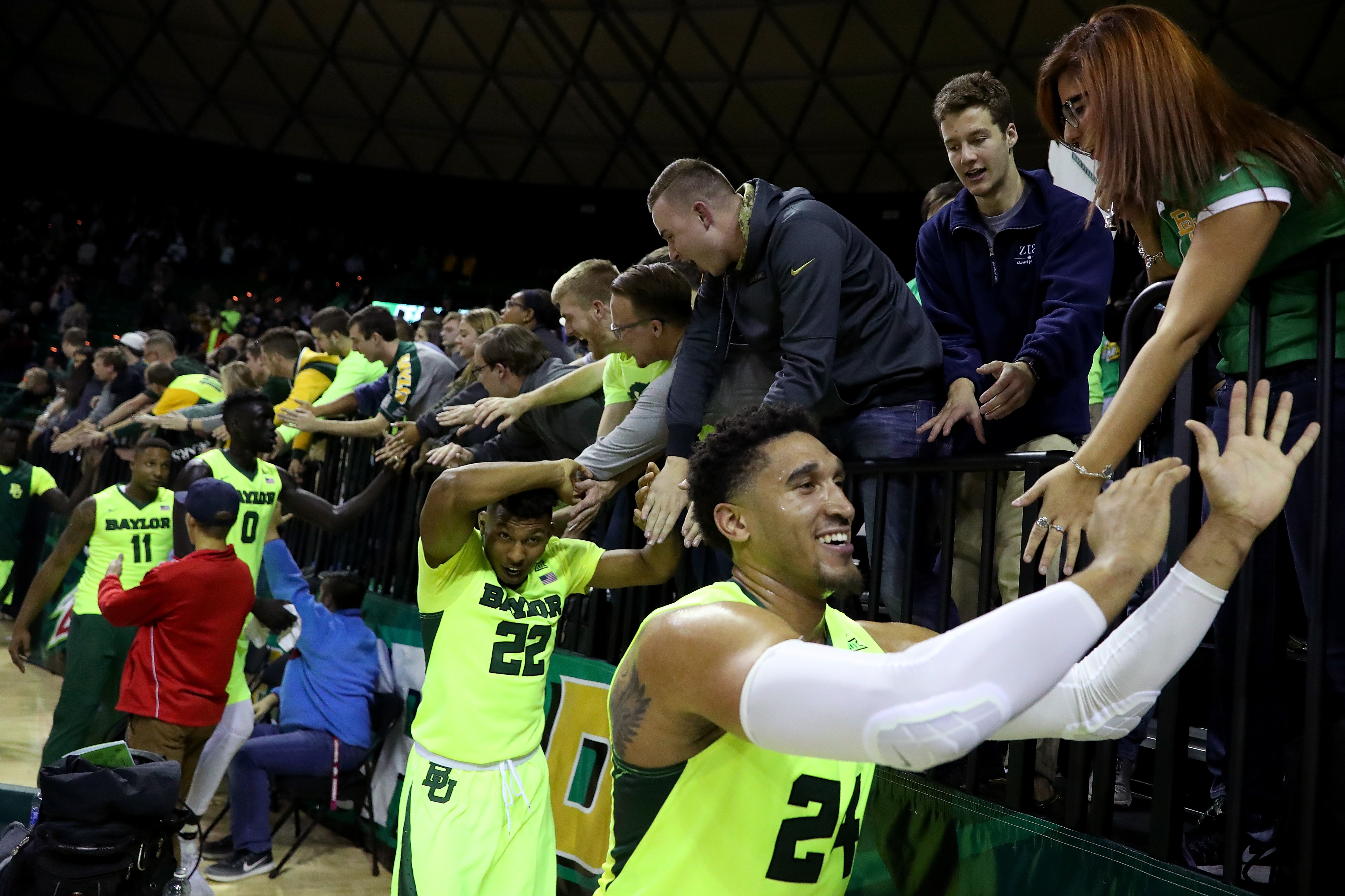 WACO, TX - JANUARY 04: Ishmail Wainright #24 of the Baylor Bears and King McClure #22 of the Baylor Bears celebrate with fans after beating the Iowa State Cyclones 65-63 at Ferrell Center on January 4, 2017 in Waco, Texas. (Photo by Tom Pennington/Getty Images)