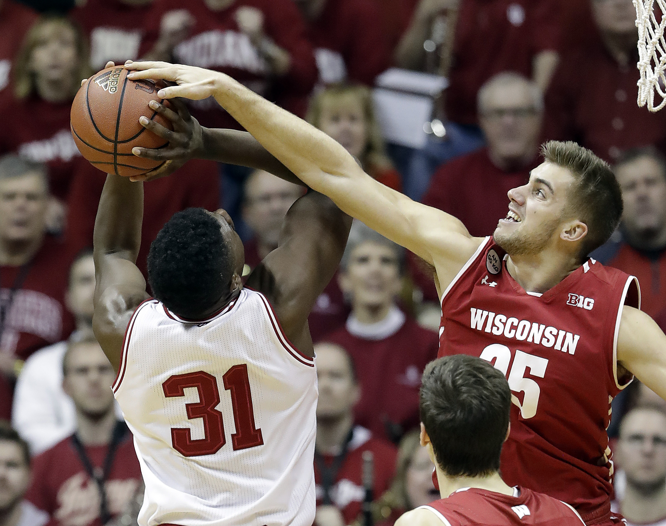 Indiana's Thomas Bryant has his shot blocked by Wisconsin's Alex Illikainen during the first half of an NCAA college basketball game Tuesday, Jan. 3, 2017, in Bloomington Ind. (AP Photo/Darron Cummings)