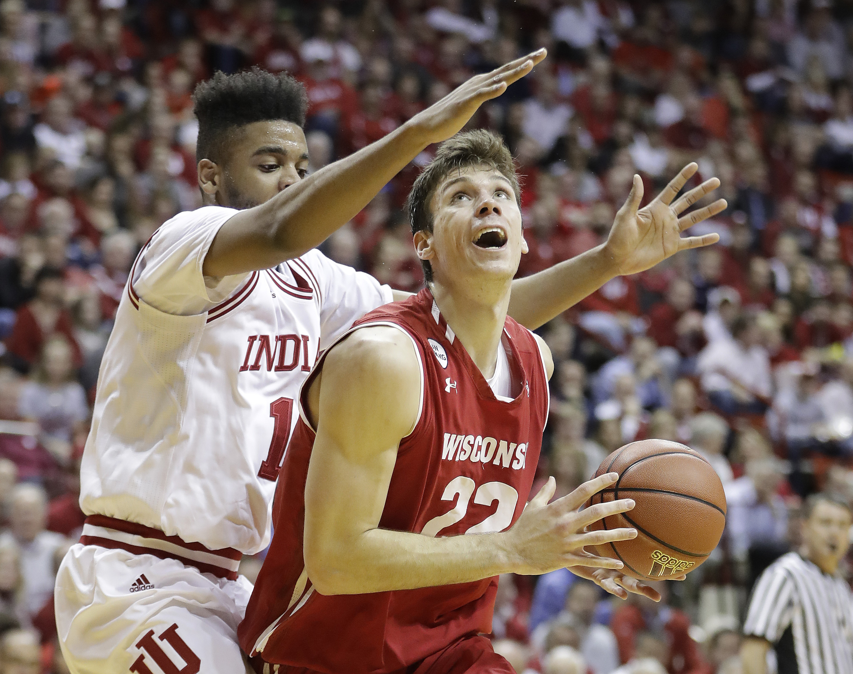 Wisconsin's Ethan Happ is defended by Indiana's Juwan Morgan during the first half of an NCAA college basketball game Tuesday, Jan. 3, 2017, in Bloomington Ind. (AP Photo/Darron Cummings)