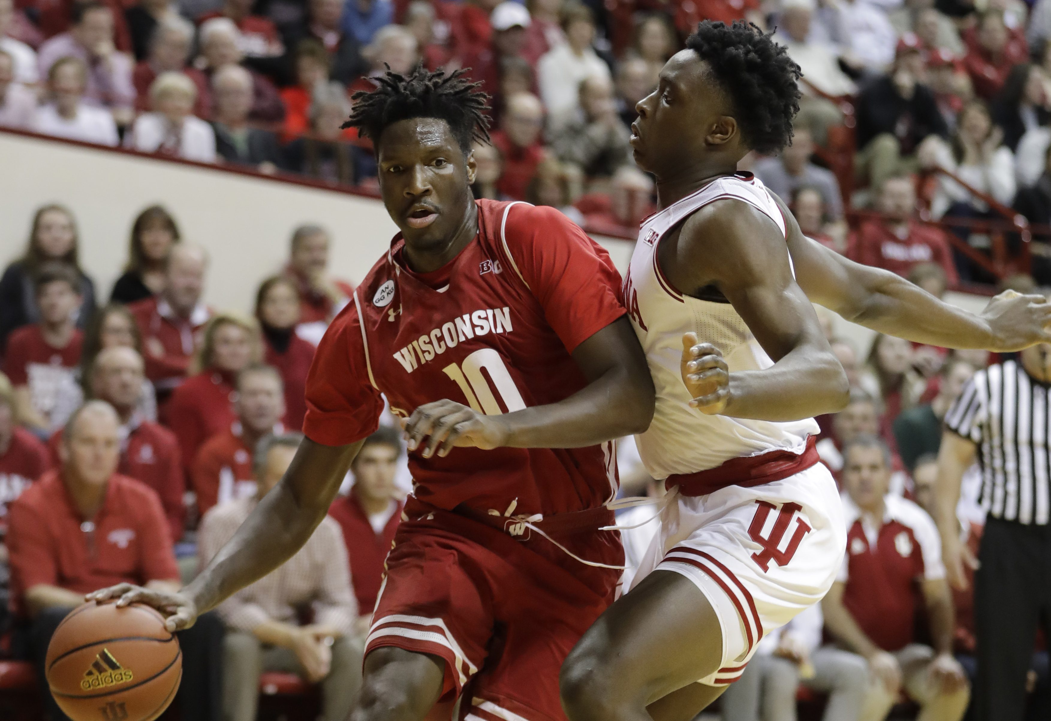 Wisconsin's Nigel Hayes is defended by Indiana's OG Anunoby during the first half of an NCAA college basketball game Tuesday, Jan. 3, 2017, in Bloomington Ind. (AP Photo/Darron Cummings)
