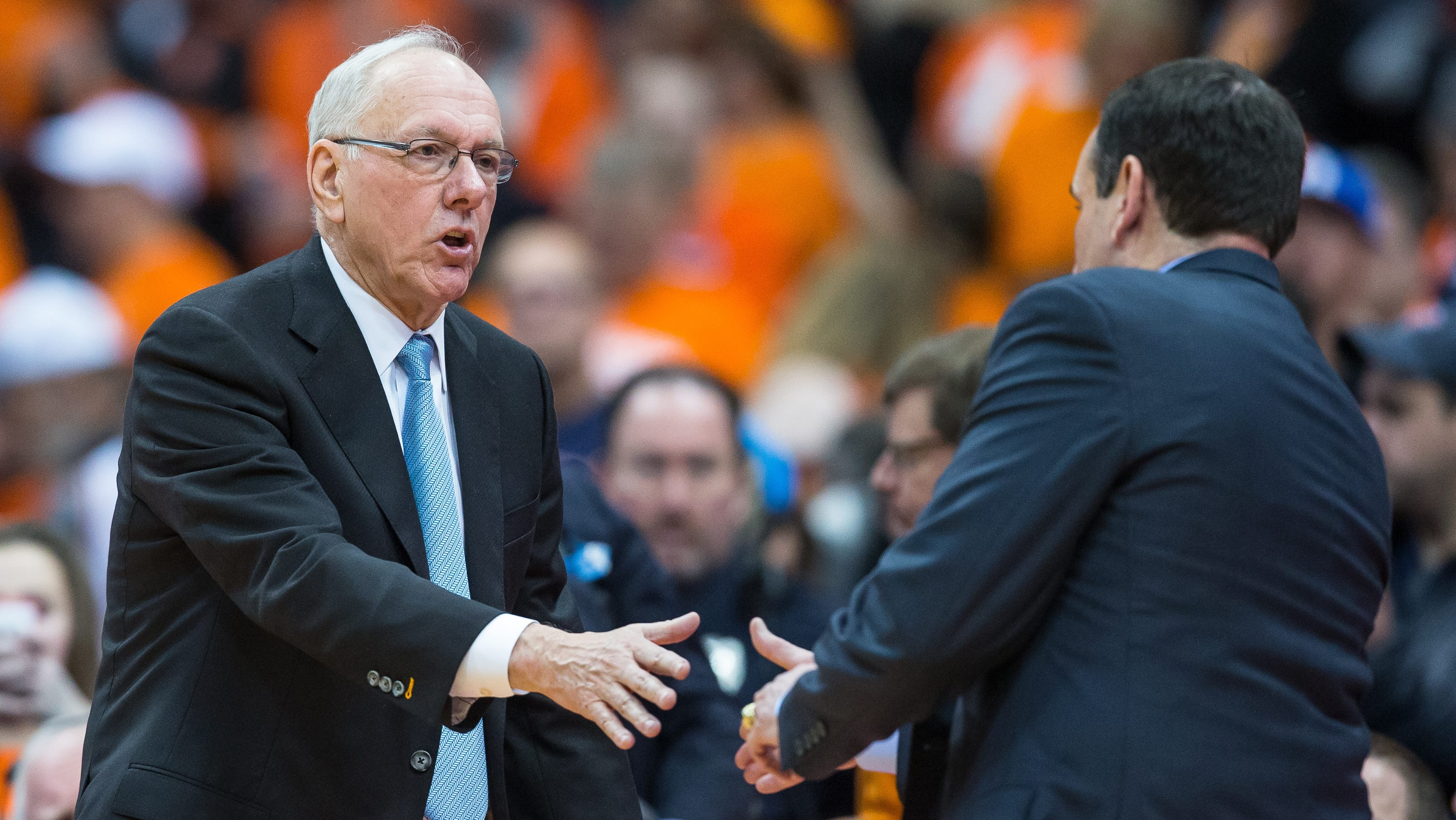 SYRACUSE, NY - FEBRUARY 14: Head coach Jim Boeheim of the Syracuse Orange shakes the hand of Head coach Mike Krzyzewski of the Duke Blue Devils after the game on February 14, 2015 at The Carrier Dome in Syracuse, New York. Duke defeats Syracuse 80-72. (Photo by Brett Carlsen/Getty Images)