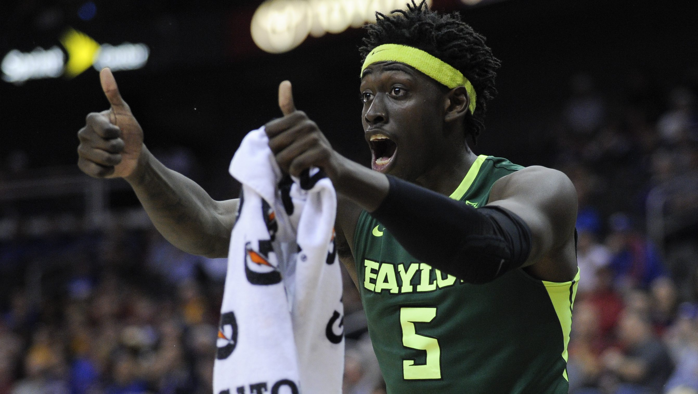 KANSAS CITY, MO - MARCH 10: Johnathan Motley #5 of the Baylor Bears cheers on his team during a game Texas Longhorns in the first half during the quarterfinals of the Big 12 Basketball Tournament at Sprint Center on March 10, 2016 in Kansas City, Missouri. (Photo by Ed Zurga/Getty Images)