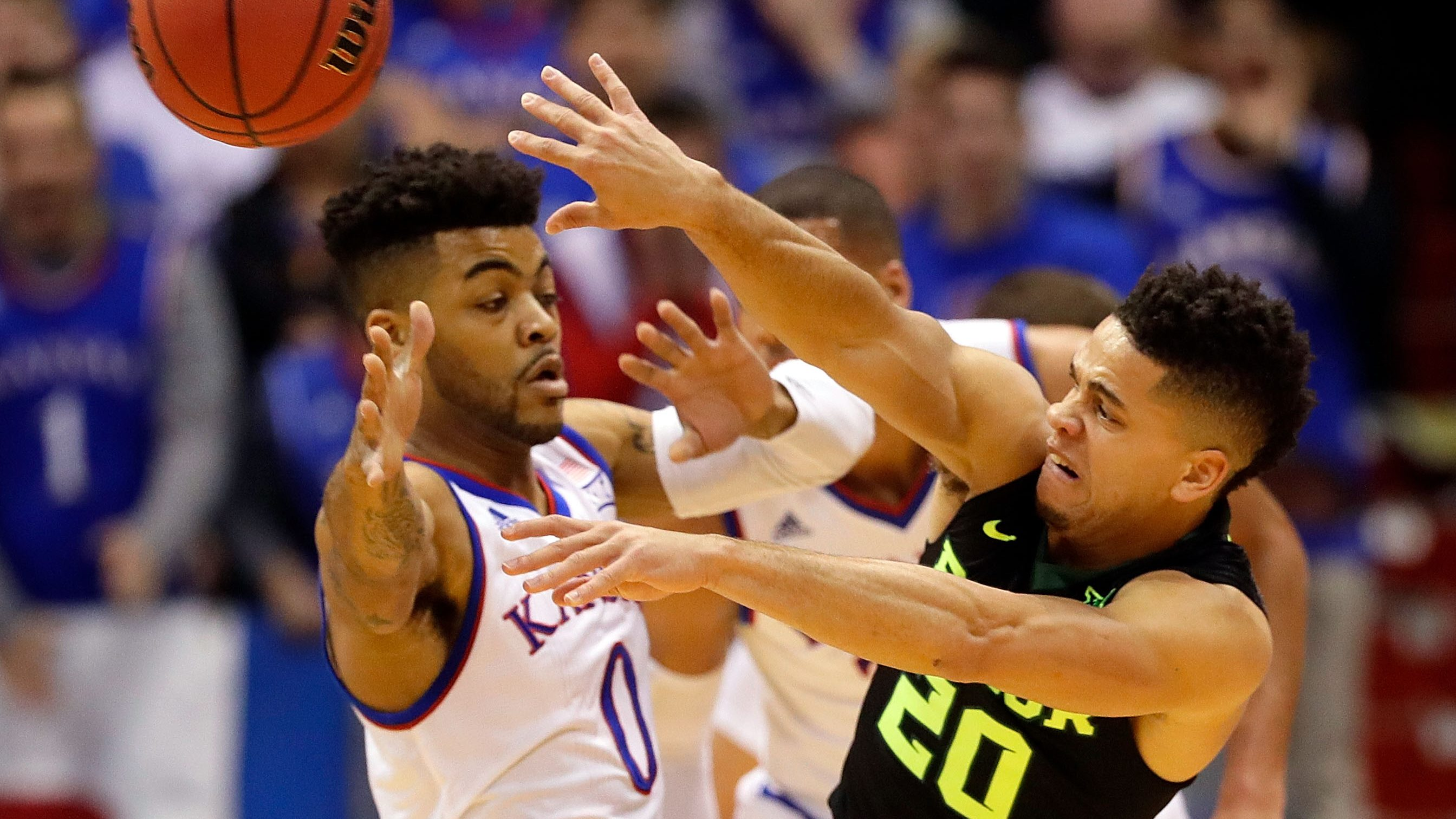 LAWRENCE, KS - FEBRUARY 01: Manu Lecomte #20 of the Baylor Bearspasses as Frank Mason III #0 of the Kansas Jayhawks defends during the game at Allen Fieldhouse on February 1, 2017 in Lawrence, Kansas. (Photo by Jamie Squire/Getty Images)