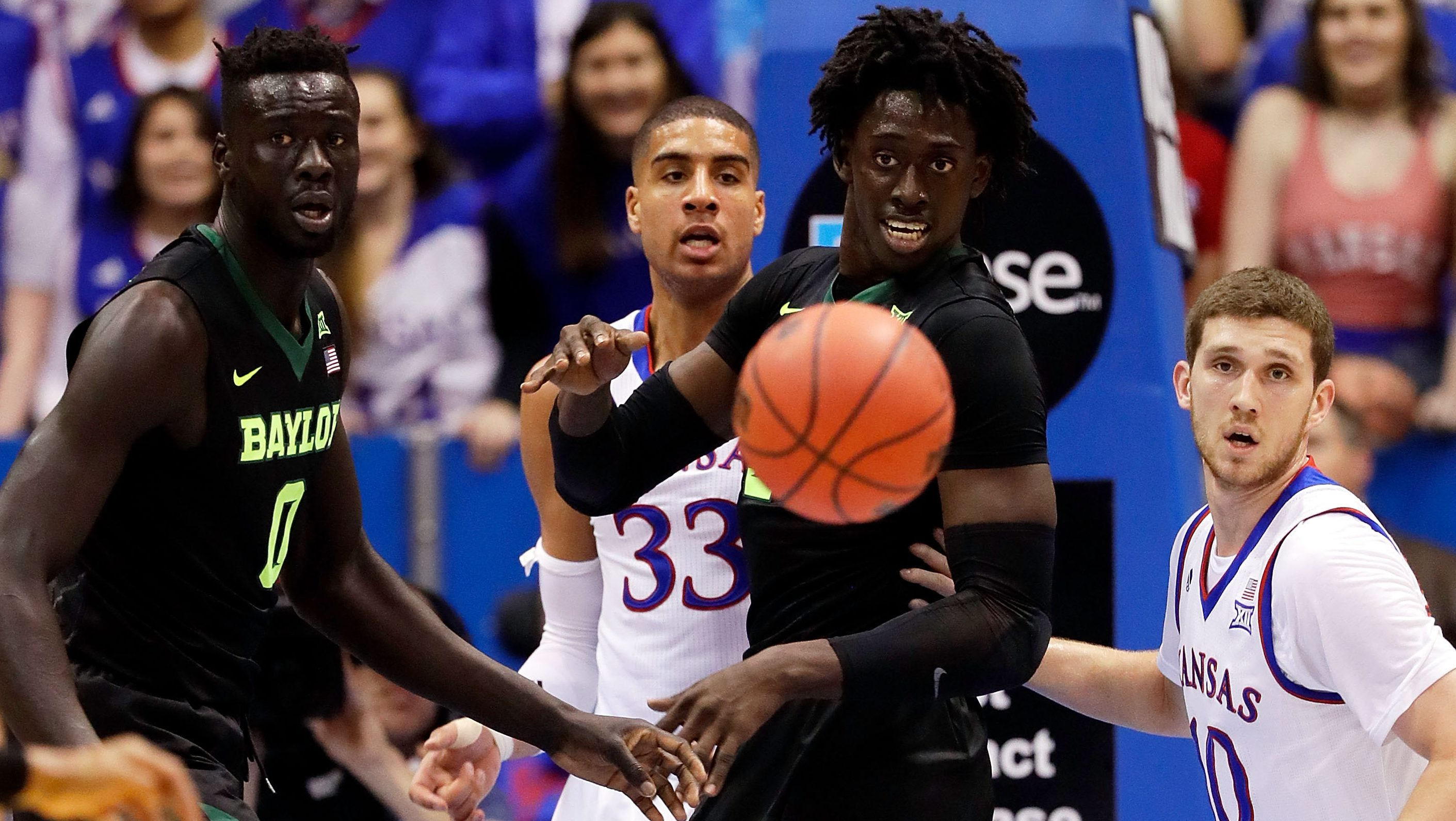 LAWRENCE, KS - FEBRUARY 01: Jo Lual-Acuil Jr. #0 and Johnathan Motley #5 of the Baylor Bears watch a loose ball during the game against the Kansas Jayhawks at Allen Fieldhouse on February 1, 2017 in Lawrence, Kansas. (Photo by Jamie Squire/Getty Images)