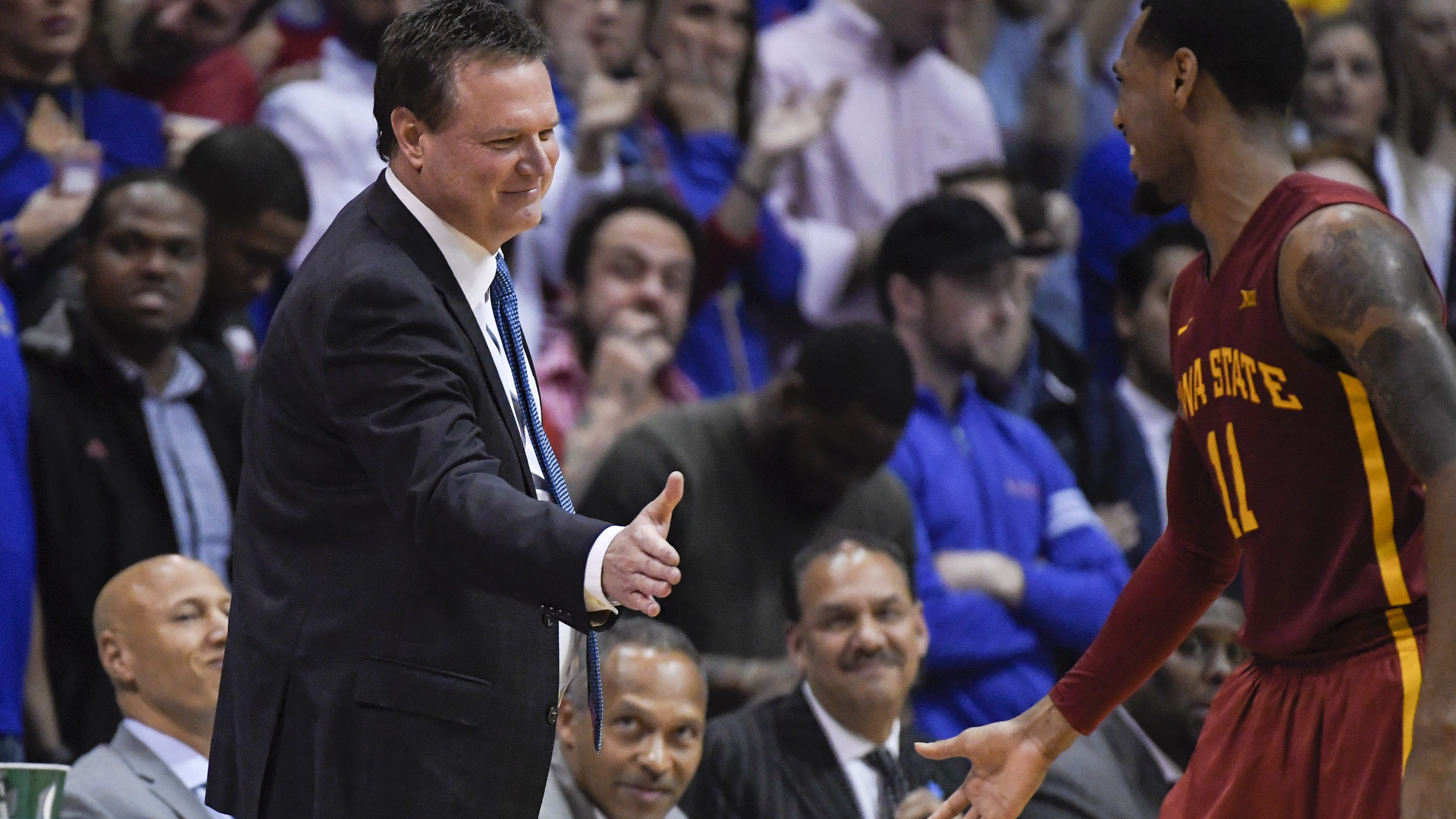 LAWRENCE, KS - FEBRUARY 04: Head coach Bill Self of the Kansas Jayhawks greets Monte Morris #11 of the Iowa State Cyclones during a break in their game on February 4, 2017 at Allen Field House in Lawrence, Kansas. (Photo by Reed Hoffmann/Getty Images)