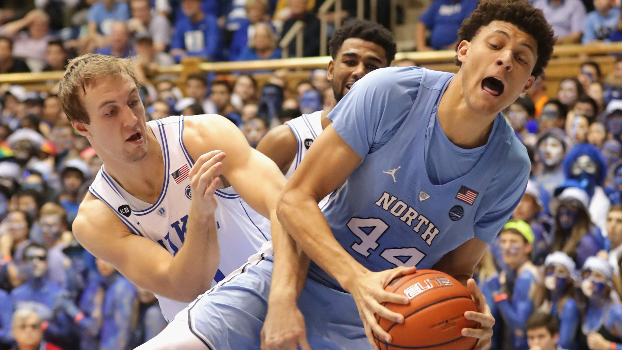 DURHAM, NC - FEBRUARY 09:  Luke Kennard #5 of the Duke Blue Devils battles for a loose ball against Justin Jackson #44 of the North Carolina Tar Heels during their game at Cameron Indoor Stadium on February 9, 2017 in Durham, North Carolina.  (Photo by Streeter Lecka/Getty Images)