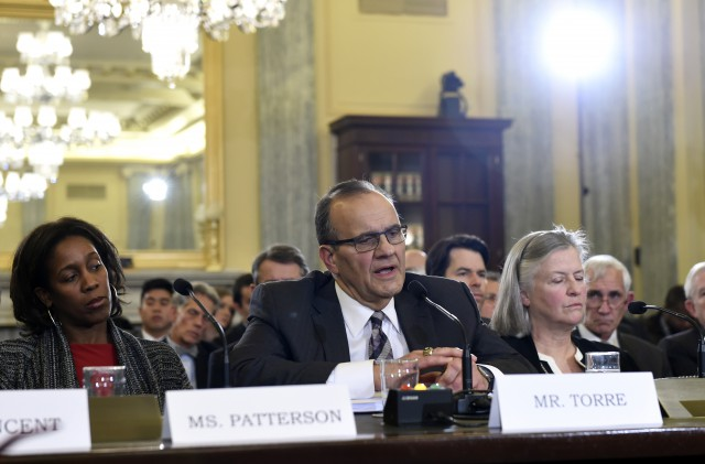 """Major League Baseball Executive Vice President of Baseball Operations Joe Torre, center, testifies on Capitol Hill in Washington, Tuesday, Dec. 2, 2014, before the Senate Commerce Committee hearing on domestic violence in professional sports. Sen. Jay Rockefeller, the West Virginia Democrat who chairs the panel, says he called for Tuesday's hearing because """"until very recently, the leagues' records have not been very good"""" on the issue. Torre is flanked by Deputy Managing Director for the?National Football League Players' Association Teri Patterson, left, and Counsel for the Major League Baseball Players Association Virginia Seitz. (AP Photo/Susan Walsh)"""