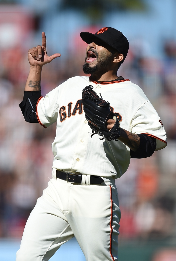 SAN FRANCISCO, CA - AUGUST 16: Sergio Romo #54 of the San Francisco Giants celebrates after defeating the Philadelphia Phillies 6-5 at AT&T Park on August 16, 2014 in San Francisco, California. (Photo by Thearon W. Henderson/Getty Images)