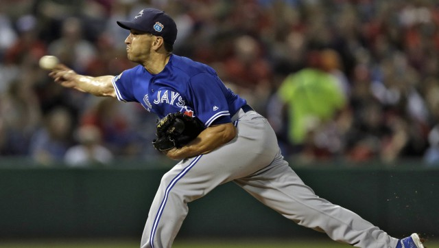 Toronto Blue Jays' Pat Venditte pitches to the Philadelphia Phillies during the fourth inning of a spring training baseball game Friday, March 25, 2016, in Clearwater, Fla. (AP Photo/Chris O'Meara)