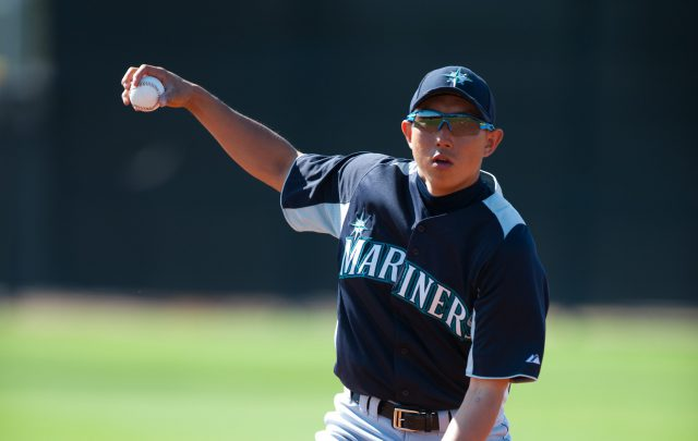 PEORIA, AZ - FEBRUARY 27: Munenori Kawasaki #61 of the Seattle Mariners practices during a workout session at the Peoria Sports Complex on February 27, 2012 in Peoria, Arizona. (Photo by Rob Tringali/Getty Images)