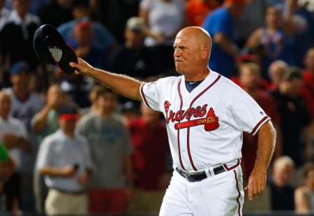ATLANTA, GA - JUNE 23: Brian Snitker #43 of the Atlanta Braves reacts after being ejected by third base umpire Mike Everitt #57 from arguing the call on the video review initiated from Emilio Bonifacio #64 being called out at homeplate against Travis d'Arnaud #7 of the New York Mets to end the seventh inning at Turner Field on June 23, 2016 in Atlanta, Georgia. (Photo by Kevin C. Cox/Getty Images)