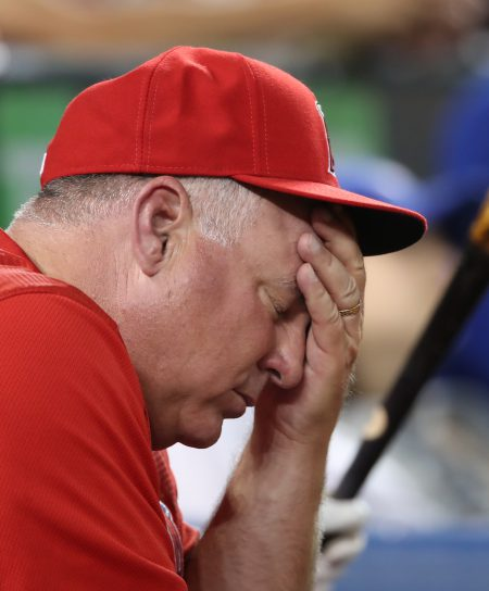 TORONTO, CANADA - AUGUST 23: Manager Mike Scioscia #14 of the Los Angeles Angels of Anaheim reacts during MLB game action against the Toronto Blue Jays on August 23, 2016 at Rogers Centre in Toronto, Ontario, Canada. (Photo by Tom Szczerbowski/Getty Images)
