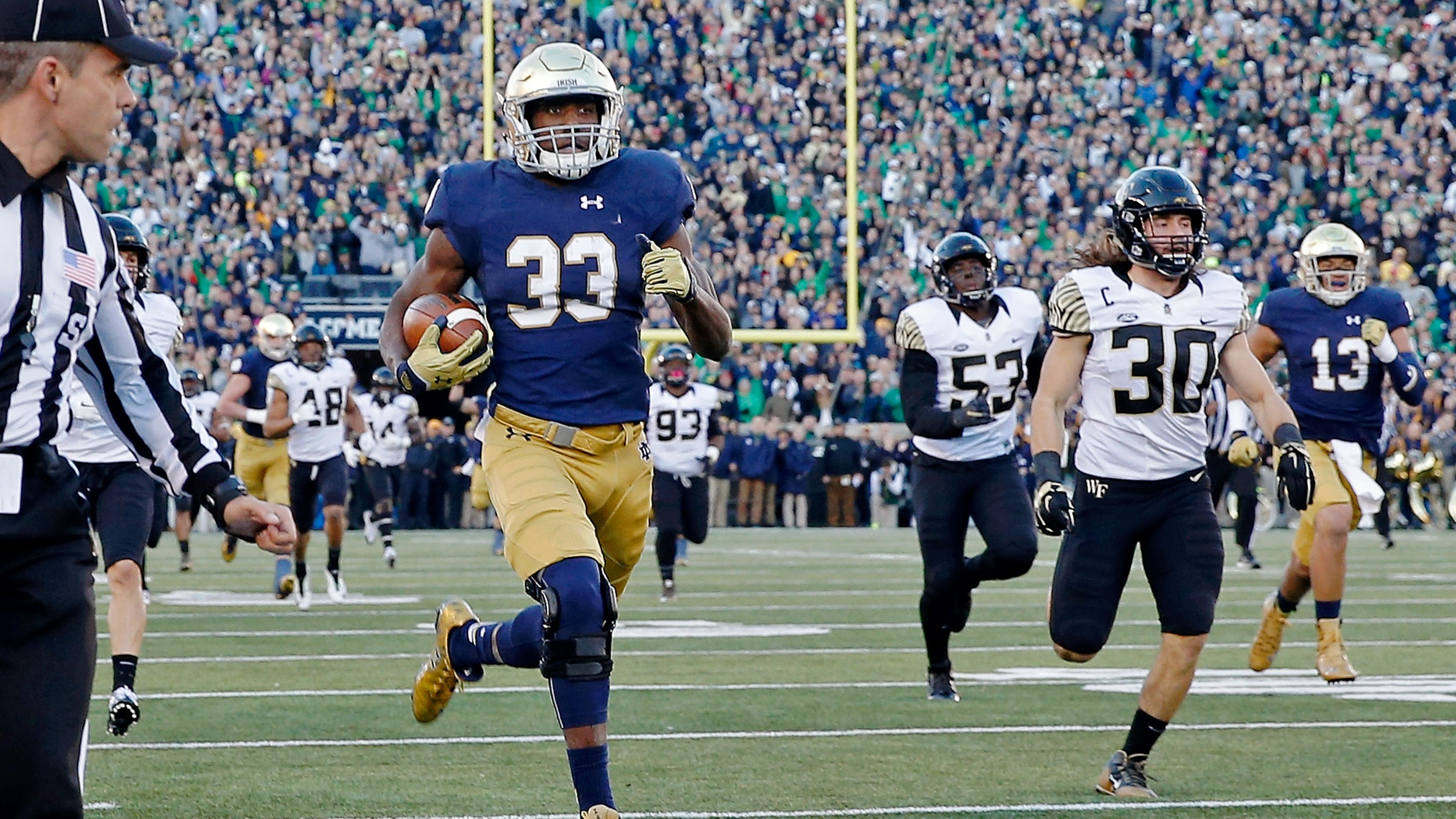 SOUTH BEND, IN - NOVEMBER 14: Josh Adams #33 of the Notre Dame Fighting Irish rushes for a 98-yard touchdown against the Wake Forest Demon Deacons during the second quarter at Notre Dame Stadium on November 14, 2015 in South Bend, Indiana. (Photo by Jon Durr/Getty Images)