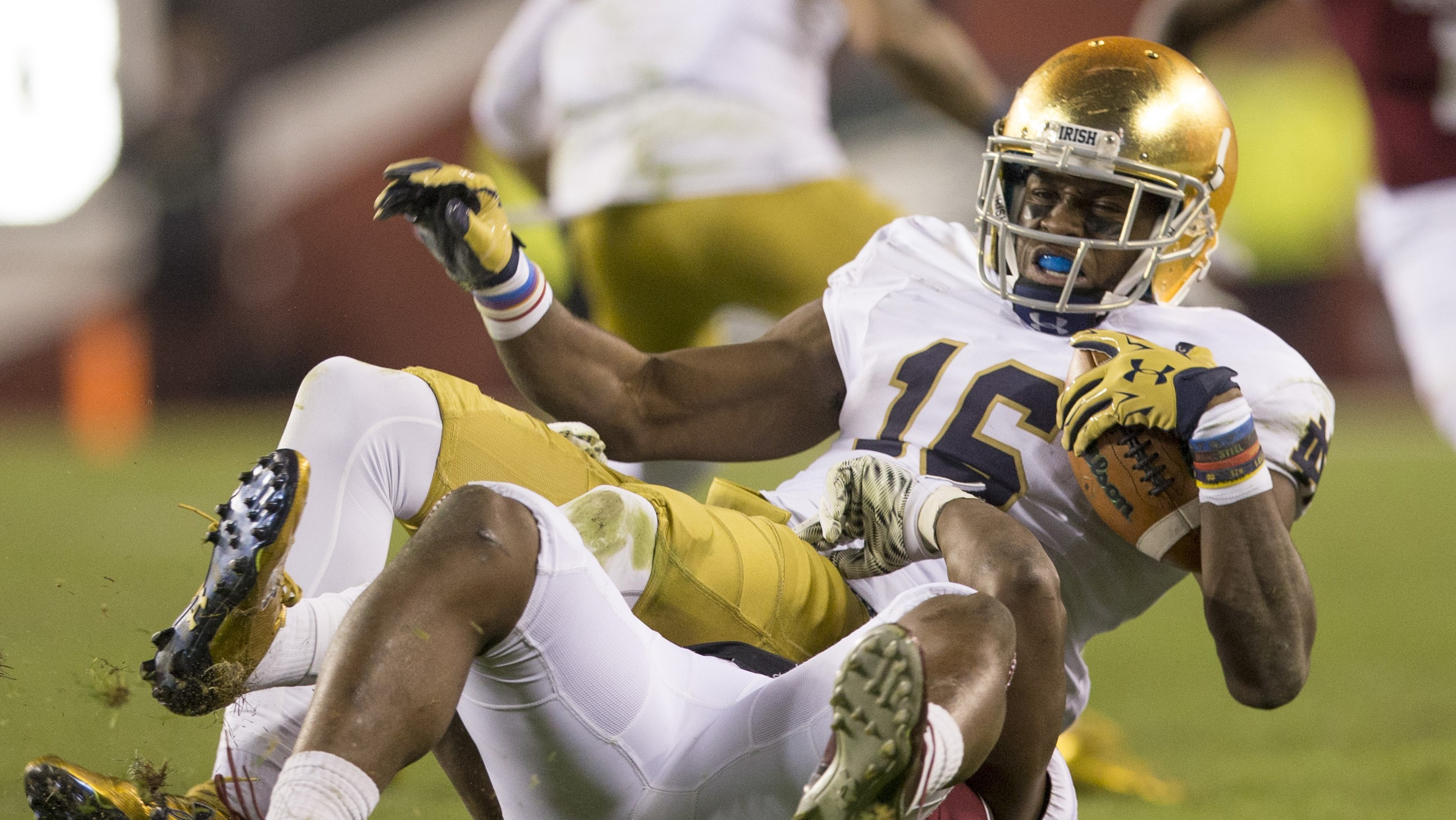 PHILADELPHIA, PA - OCTOBER 31: Torii Hunter Jr. #16 of the Notre Dame Fighting Irish catches a pass and is tackled by Avery Williams #2 of the Temple Owls on October 31, 2015 at Lincoln Financial Field in Philadelphia, Pennsylvania. The Notre Dame Fighting Irish defeated the Temple Owls 24-20. (Photo by Mitchell Leff/Getty Images)