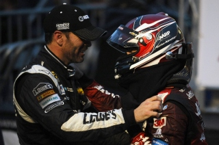 MARTINSVILLE, VA - NOVEMBER 01: Jeff Gordon, driver of the #24 AARP Member Advantages Chevrolet, is congratulated by Jimmie Johnson, driver of the #48 KOBALT TOOLS Chevrolet, after winning the NASCAR Sprint Cup Series Goody's Headache Relief Shot 500 at Martinsville Speedway on November 1, 2015 in Martinsville, Virginia. (Photo by Rainier Ehrhardt/Getty Images)