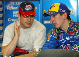 CONCORD, NC - MAY 25: Jeff Gordon, driver of the #24 Dupont Chevrolet speaks with Kyle Busch, driver of the #5 Kellogg's Chevrolet, during NASCAR Nextel Cup Series Coca-Cola 600 practice on May 25, 2006 at Lowes Motor Speedway in Concord, North Carolina. (Photo by Rusty Jarrett/Getty Images for NASCAR)