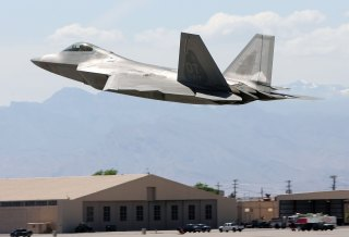 NELLIS AFB, NV - APRIL 25: A United States Air Force F-22 Raptor takes off from Nellis Air Force Base while participating in the Joint Expeditionary Force Experiment 2006 (JEFX 06) April 25, 2006 in Las Vegas, Nevada. JEFX is a biannual test of new systems and technologies by every branch of the military in an attempt to speed their introduction into the modern battlefield. This year's tests involve about 1,400 personnel from the United States, Great Britain, Canada and Australia studying new technologies during mock combat over the Nevada desert and center on finding better ways to communicate critical information between armed forces. (Photo by Ethan Miller/Getty Images)