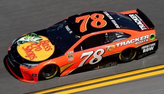DAYTONA BEACH, FL - FEBRUARY 13: Martin Truex Jr., driver of the #78 Bass Pro Shops/Tracker Boats Toyota, practices for the NASCAR Sprint Cup Series Daytona 500 at Daytona International Speedway on February 13, 2016 in Daytona Beach, Florida. (Photo by Jared C. Tilton/Getty Images)