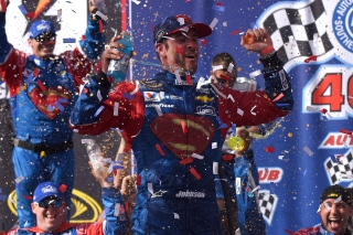 FONTANA, CA - MARCH 20: Jimmie Johnson, driver of the #48 Lowe's / Superman Chevrolet, celebrates in victory lane after winning the NASCAR Sprint Cup Series Auto Club 400 at Auto Club Speedway on March 20, 2016 in Fontana, California. (Photo by Jonathan Moore/Getty Images)