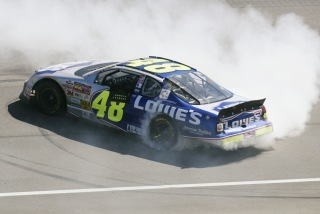28 Apr 2002: Gordon Racing driver Jimmie Johnson celebrates by doing donuts on the front stretch after winning the NASCAR Winston Cup Series NAPA Auto Parts 500 at the California Speedway in Fontana, California.DIGITAL IMAGE. Mandatory Credit: Jeff Gross/Getty Images.