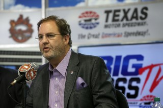 "FORT WORTH, TX - MARCH 19: Texas Motor Speedway President Eddie Gossage speaks during the press conference for the unveiling of ""Big Hoss"" the largest HD video board in the world at Texas Motor Speedway on March 19, 2014 in Fort Worth, Texas. (Photo by Gary Miller/Getty Images for Texas Motor Speedway)"