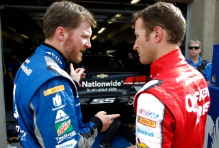Dale Earnhardt Jr. (left) and Kasey Kahne discuss pre-race strategy prior to Saturday night's Duck Commander 500 at Texas Motor Speedway. All four Hendrick Motorsports drivers finished in the top 8, including Earnhardt (2nd) and Kahne (8th).