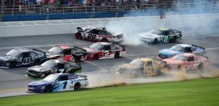 TALLADEGA, AL - APRIL 30: Joey Logano, driver of the #22 Discount Tire Ford, and Blake Koch, driver of the #11 LeafFilter Gutter Protection Chevrolet, have an on track incident in the final lap of the NASCAR XFINITY Series Sparks Energy 300 at Talladega Superspeedway on April 30, 2016 in Talladega, Alabama. (Photo by Jared C. Tilton/Getty Images)