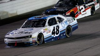 FORT WORTH, TEXAS - APRIL 08: Brennan Poole, driver of the #48 DC Solar Chevrolet, leads Austin Dillon, driver of the #2 Ruud/Smurfit Kappa Chevrolet, during the NASCAR XFINITY Series O'Reilly Auto Parts 300 at Texas Motor Speedway on April 8, 2016 in Fort Worth, Texas. (Photo by Ron Jenkins/Getty Images)