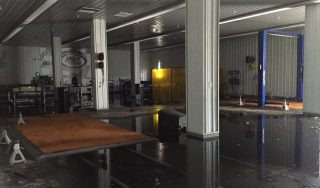Water flooded part of the ThorSport Racing shop after firefighters battled a blaze at the shop Monday. (Photo by ThorSport Racing)
