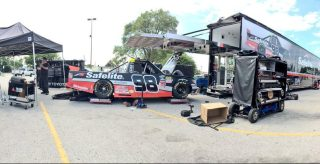 Each of ThorSport Racing's four teams worked in the parking lot of a grocery store after Monday's fire at the race shop. (Photo by Rico Abreu)