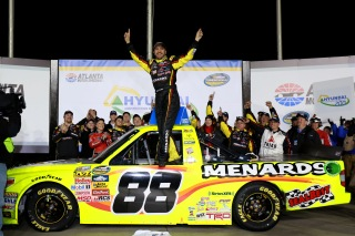 HAMPTON, GA - FEBRUARY 28: Matt Crafton, driver of the #88 Fisher Nuts/Menards Toyota, celebrates in victory lane after winning the NASCAR Camping World Truck Series Hyundai Construction Equipment 200 on February 28, 2015 in Hampton, Georgia. (Photo by Jerry Markland/Getty Images)