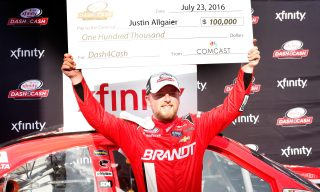 INDIANAPOLIS, IN - JULY 23: Justin Allgaier, driver of the #7 BRANDT Chevrolet, celebrates after winning the Dash for Cash at the NASCAR XFINITY Series Lilly Diabetes 250 at Indianapolis Motor Speedway on July 23, 2016 in Indianapolis, Indiana. (Photo by Brian Lawdermilk/Getty Images)