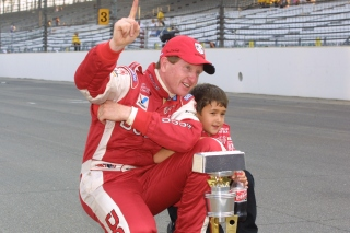Chase Elliott and his father celebrate after the 2002 Brickyard 400 (photo by Indianapolis Motor Speedway).
