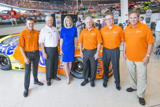 From left: NASCAR Sprint Cup Series driver Matt Kenseth, team owner Joe Gibbs, Tide Brand Manager Amy Krehbiel, and former Tide Legend drivers Ricky Rudd, Ricky Craven and Darrell Waltrip pose for a photo in front of the newly unveiled No. 20 Tide PODS Toyota Camry paint scheme at the NASCAR Hall of Fame in Charlotte, NC Tuesday, August 16, 2016. (Jason E. Miczek/AP Images for Tide PODS)