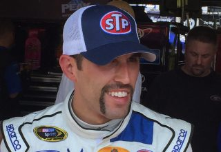 Aric Almirola sported a Fu Manchu mustache at last year's Southern 500 in honor of Richard Petty. (Photo: Dustin Long)