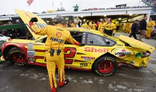 MARTINSVILLE, VA - NOVEMBER 01: The #22 Shell Pennzoil Ford of Joey Logano is towed into the garage after an incident with Matt Kenseth, driver of the #20 Dollar General Toyota, during the NASCAR Sprint Cup Series Goody's Headache Relief Shot 500 at Martinsville Speedway on November 1, 2015 in Martinsville, Virginia. (Photo by Jonathan Moore/Getty Images)