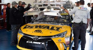 TALLADEGA, AL - OCTOBER 22:  Matt Kenseth, driver of the #20 DeWalt Flexvolt Toyota, goes through inspection during qualifying for the NASCAR Sprint Cup Series Hellmann's 500 at Talladega Superspeedway on October 22, 2016 in Talladega, Alabama.  (Photo by Jared C. Tilton/Getty Images)
