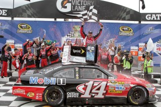 JOLIET, IL - SEPTEMBER 19: Tony Stewart, driver of the #14 Office Depot/Mobil 1 Chevrolet, celebrates in victory lane after winning the NASCAR Sprint Cup Series GEICO 400 at Chicagoland Speedway on September 19, 2011 in Joliet, Illinois. (Photo by Jerry Markland/Getty Images for NASCAR)