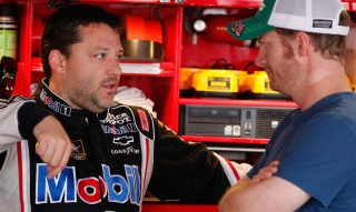 DOVER, DE - JUNE 01: Tony Stewart, driver of the #14 Mobil 1/Office Depot Chevrolet, talks to Dale Earnhardt Jr., driver of the #88 AMP Energy/National Guard Chevrolet, in the garage area during practice for the NASCAR Sprint Cup Series FedEx 400 benefiting Autism Speaks at Dover International Speedway on June 1, 2012 in Dover, Delaware. (Photo by Rob Carr/Getty Images for NASCAR)