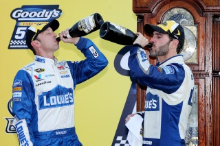 MARTINSVILLE, VA - OCTOBER 30: Jimmie Johnson, driver of the #48 Lowe's Chevrolet, celebrates with champagne in Victory Lane with crew chief Chad Knaus after winning the NASCAR Sprint Cup Series Goody's Fast Relief 500 at Martinsville Speedway on October 30, 2016 in Martinsville, Virginia. (Photo by Jerry Markland/Getty Images)