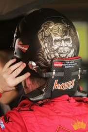 MARTINSVILLE, VA - MARCH 31: Dale Earnhardt Jr., driver of the #8 Budweiser Chevrolet, puts on his helmet prior to practice for the NASCAR Nextel Cup Series Goody's Cool Orange 500 at Martinsville Speedway on March 31, 2007 in Martinsville, Virginia. (Photo by Chris McGrath/Getty Images)