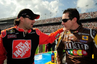 DAYTONA BEACH, FL - FEBRUARY 17: Tony Stewart, driver of the #20 The Home Depot Toyota, speaks with teammate Kyle Busch, driver of the #18 M&M's Toyota, prior to the NASCAR Sprint Cup Series Daytona 500 at Daytona International Speedway on February 17, 2008 in Daytona Beach, Florida. (Photo by Rusty Jarrett/Getty Images for NASCAR)