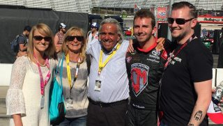 Matt DiBenedetto celebrates with his family after finishing a career-high sixth at Bristol in the spring. DiBenedetto's father is in the center and DiBenedetto's mom is to the left of DiBenedetto's father. (Photo: Dustin Long)
