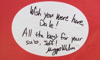 A fan's note to Dale Earnhardt and his sub, Jeff Gordon, on the No. 88 team's pit wall at Indianapolis Motor Speedway (Photo: Dustin Long)